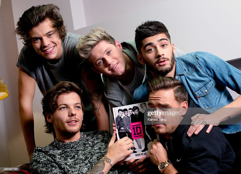 Harry Styles, Louis Tomlinson, Niall Horan, Zayn Malik and Liam Payne of One Direction attends the booksigning of One Direction's new book 'Where We Are' held at Alexandra Palace on November 18, 2013 in London, England.