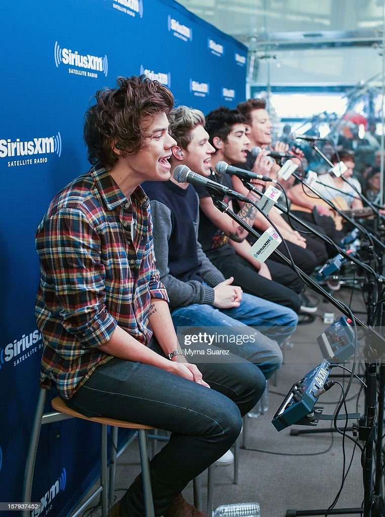 Harry Styles, Niall Horan, Zayn Malik and Louis Tomlinson of One Direction perform at SiriusXM's 'Artist Confidential' Series at SiriusXM Studios on December 7, 2012 in New York City.