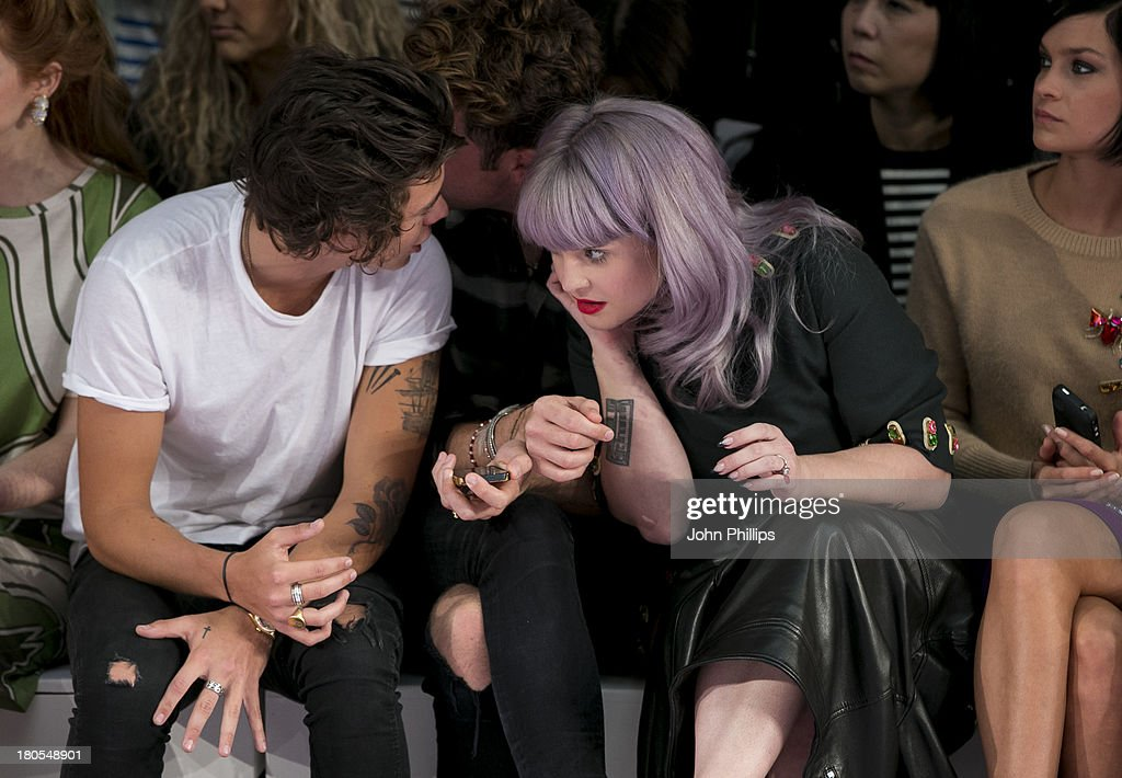 Harry Styles, Nick Grimshaw and Kelly Osbourne attends the House Of Holland show during London Fashion Week SS14 on September 14, 2013 in London, England.