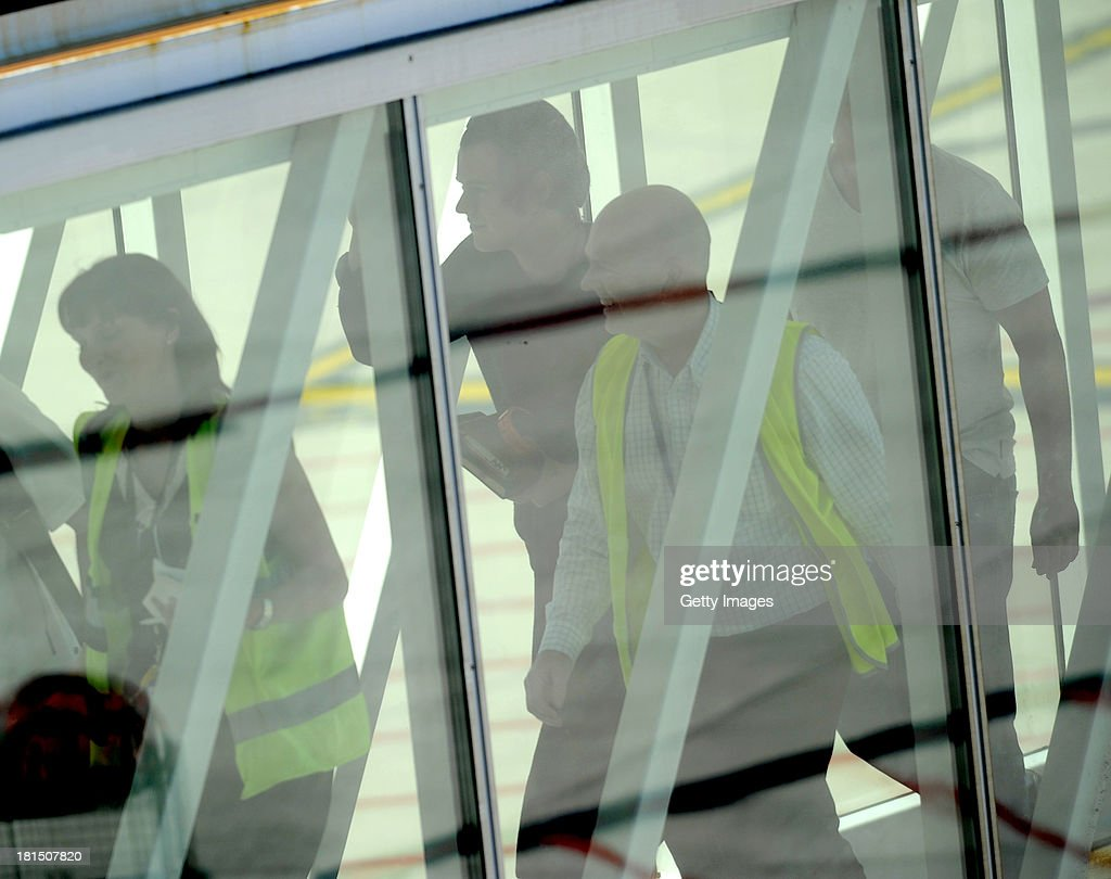 Harry Styles of One Direction arrives for the first leg of their Australian Tour at Adelaide Airport on September 22, 2013 in Adelaide, Australia.