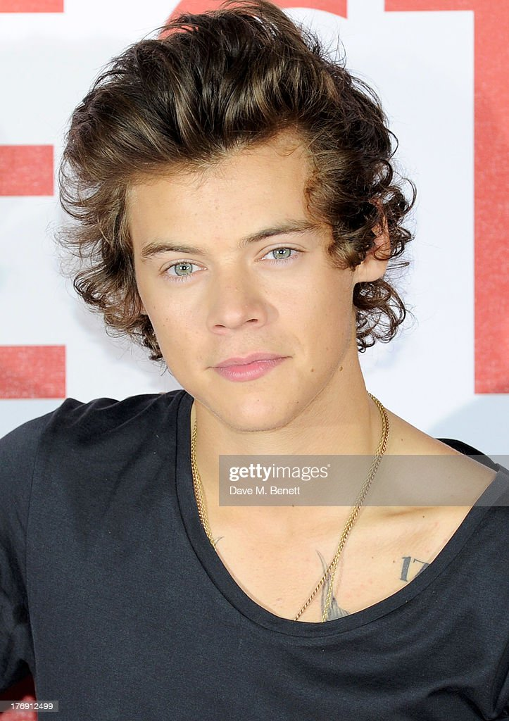 <a gi-track='captionPersonalityLinkClicked' href=/galleries/search?phrase=Harry+Styles&family=editorial&specificpeople=7229830 ng-click='$event.stopPropagation()'>Harry Styles</a> of One Direction attends a photocall to launch their new film 'One Direction: This Is Us 3D' at Big Sky Studios on August 19, 2013 in London, England.