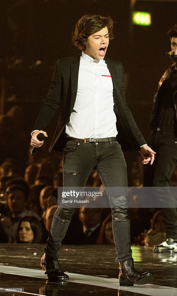 Harry Styles of One Direction performs during the Brit Awards 2013 at 02 Arena on February 20, 2013 in London, England.