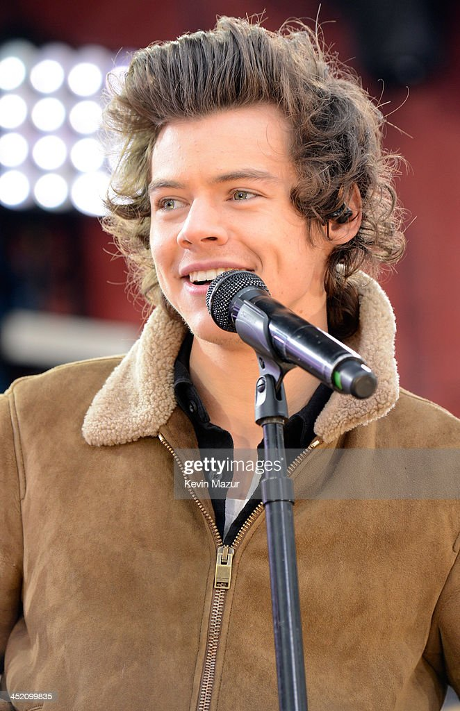 Harry Styles of One Direction performs on ABC's 'Good Morning America' at Rumsey Playfield, Central Park on November 26, 2013 in New York City.