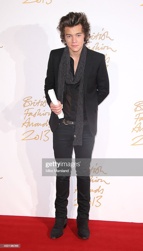 Harry Styles poses in the winners room at the British Fashion Awards 2013 at London Coliseum on December 2, 2013 in London, England.