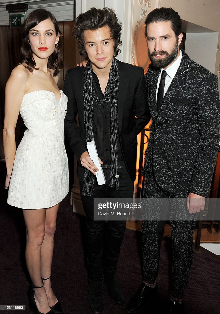 Harry Styles (C), winner of the British Style Award, poses with presenters Alexa Chung and Jack Guinness at the British Fashion Awards 2013 at London Coliseum on December 2, 2013 in London, England.