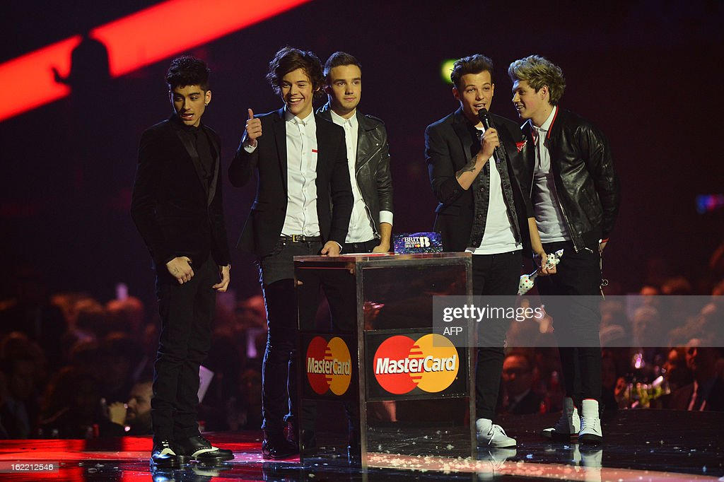 Harry Styles, Zayn Malik, Liam Payne, Louis Tomlinson, and Niall Horan of British-Irish pop band One Direction celerbate winning the Global Sucess award during the BRIT Awards 2013 ceremony in London on February 20, 2013.