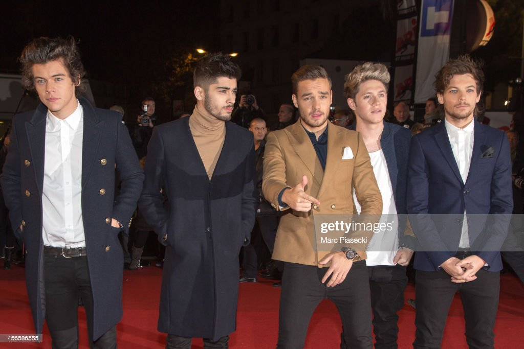 Harry Styles, Zayn Malik, Liam Payne, Niall Horan and Louis Tomlinson of One Direction attend the 15th NRJ Music Awards at Palais des Festivals on December 14, 2013 in Cannes, France.