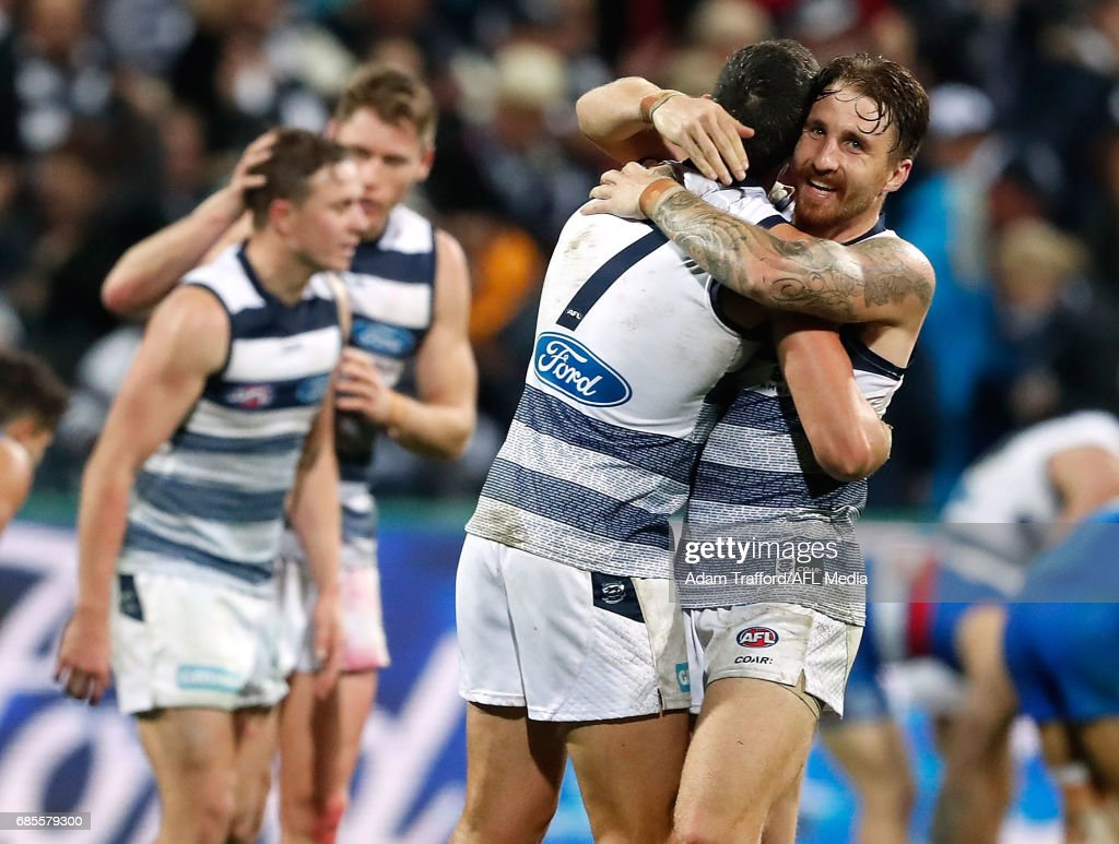 Harry Taylor (left) nand Zach Tuohy of the Cats celebrate on the final siren during the 2017 AFL round 09 match between the Geelong Cats and the Western Bulldogs at Simonds Stadium on May 19, 2017 in Geelong, Australia.