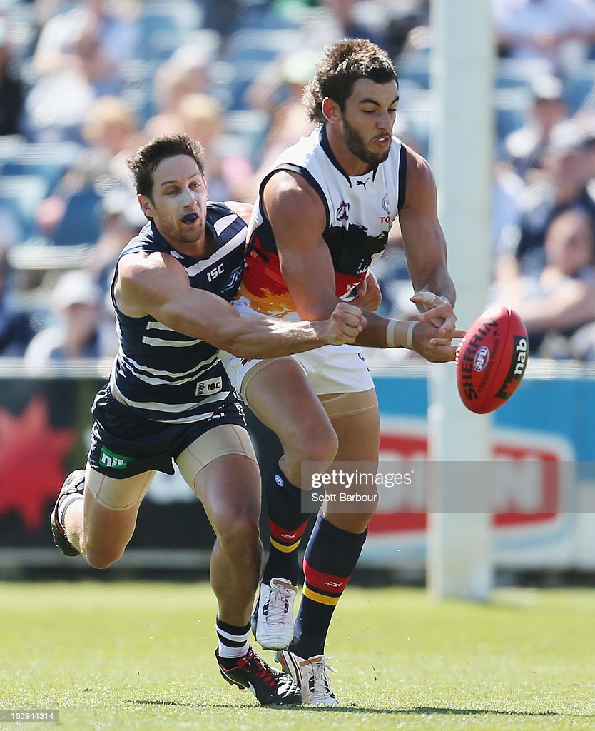Harry Taylor of the Cats and Taylor Walker of the Crows compete for the ball during the round two AFL NAB Cup match between the Geelong Cats and the Adelaide Crows at Simonds Stadium on March 2, 2013 in Geelong, Australia.