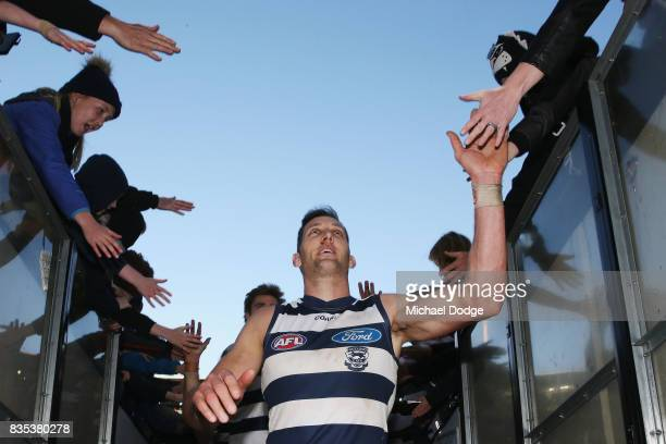 Harry Taylor of the Cats celebrates the win with fans during the round 22 AFL match between the Collingwood Magpies and the Geelong Cats at Melbourne...