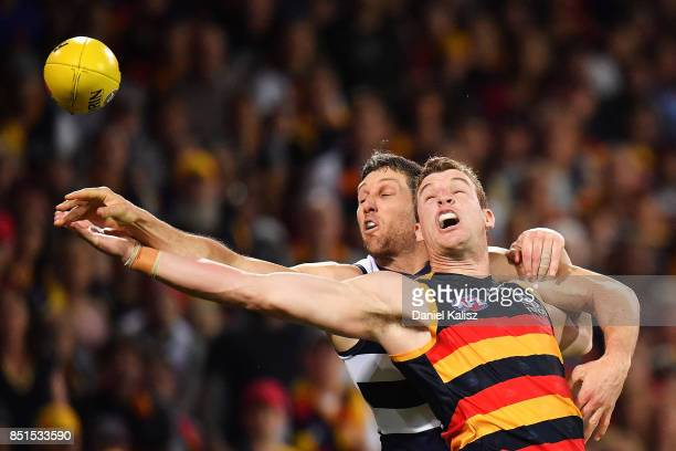 Harry Taylor of the Cats competes for the ball with Josh Jenkins of the Crows during the First AFL Preliminary Final match between the Adelaide Crows...