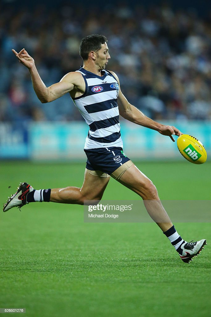 Harry Taylor of the Cats kicks the ball during the round six AFL match between the Geelong Cats and the Gold Coast Suns at Simonds Stadium on April 30, 2016 in Geelong, Australia.