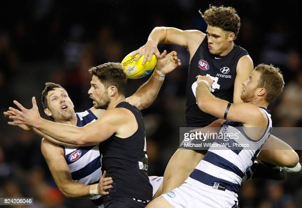 Harry Taylor of the Cats Levi Casboult of the Blues Charlie Curnow of the Blues and Lachie Henderson of the Cats compete for the ball during the 2017...