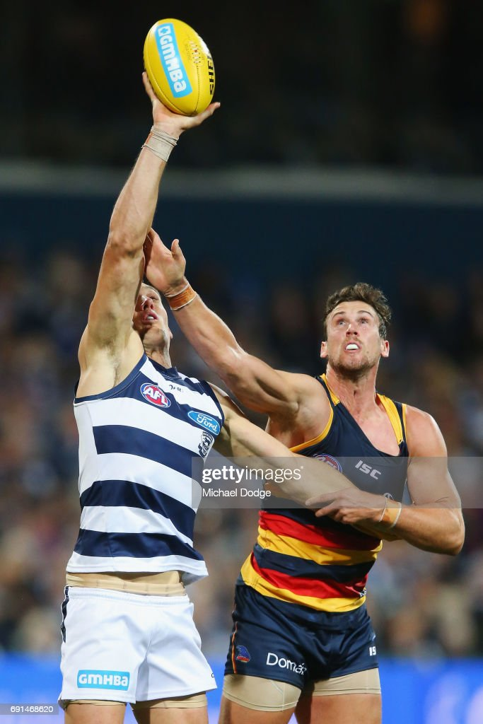 Harry Taylor of the Cats marks the ball one handed against Kyle Hartigan of the Crows during the round 10 AFL match between the Collingwood Magpies and Brisbane Lions at Melbourne Cricket Ground on May 28, 2017 in Melbourne, Australia.