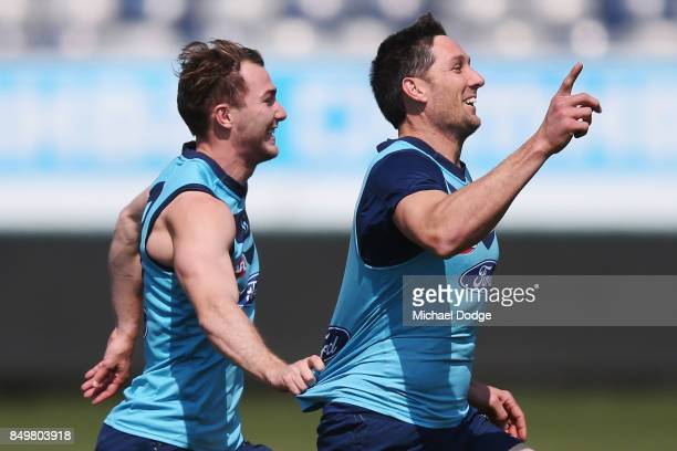 Harry Taylor of the Cats reacts after beating Jackson Thurlow of the Cats in a sprint during the Geelong Cats AFL training session at Simonds Stadium...