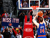 Harry the Hawk mascot for the Atlanta Hawks tries to distract Jason Smith of the New York Knicks during a free throw attempt in the second half...