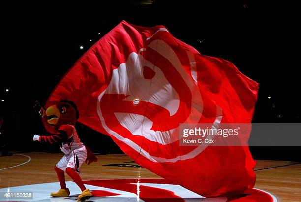 Harry the Hawk waves a flag during pregame introductions prior to the game between the Atlanta Hawks and the Memphis Grizzlies at Philips Arena on...