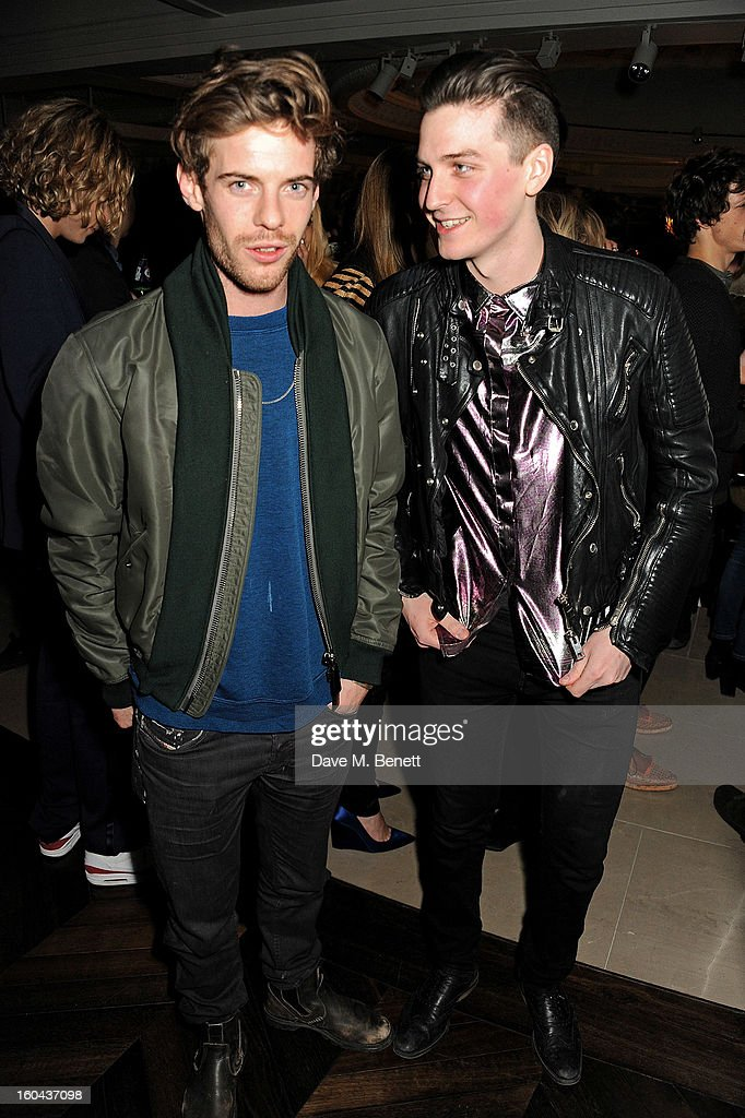 <a gi-track='captionPersonalityLinkClicked' href=/galleries/search?phrase=Harry+Treadaway&family=editorial&specificpeople=737103 ng-click='$event.stopPropagation()'>Harry Treadaway</a> (L) and George Craig, both wearing Burberry, attend the Burberry Live at 121 Regent Street event on January 31, 2013 in London, England.