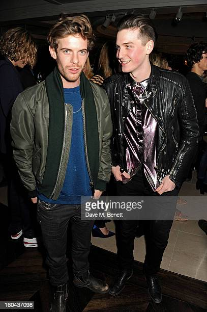 Harry Treadaway and George Craig both wearing Burberry attend the Burberry Live at 121 Regent Street event on January 31 2013 in London England