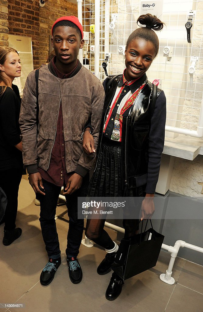 Harry Uzoka (L) and Leomie Anderson attend the launch of Casio London's Global Concept Store in Covent Garden Piazza on April 18, 2012 in London, England.