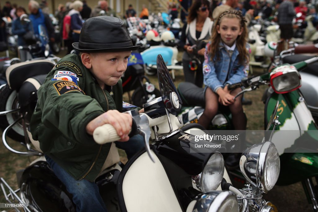 Harry Watson, 6, and sister Madelaine Watson, 9, from Derbyshire sit on Scooters ahead of the 'Ride Out', which brings the Isle of Wight Scooter Festival to a close on August 25, 2013 in Ryde, England. The annual event, which is organized by the British Scooter Rally Association and The VFM Scooter Collective, attracts around 6000 riders each year and has been running since 1980. The scooter in 1960s Britain was a fashion statement and the often heavily customized bikes, usually an Italian Vespa or Lambretta, became synonymous with the Mod scene. They provided an inexpensive mode of transport and escapism to an upwardly mobile youth at a time when public transportation stopped early. The Vespa was depicted on the cover of The Whos Quadrophenia album in 1973.