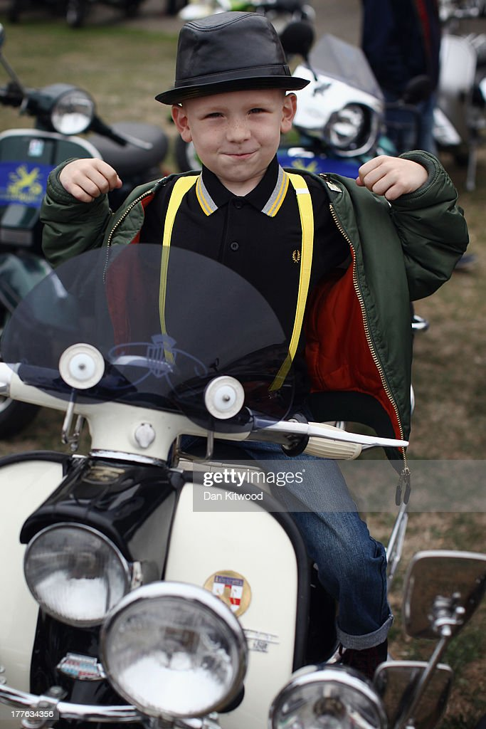 Harry Watson, 6, from Derbyshire sits on Scooters ahead of the 'Ride Out', which brings the Isle of Wight Scooter Festival to a close on August 25, 2013 in Ryde, England. The annual event, which is organized by the British Scooter Rally Association and The VFM Scooter Collective, attracts around 6000 riders each year and has been running since 1980. The scooter in 1960s Britain was a fashion statement and the often heavily customized bikes, usually an Italian Vespa or Lambretta, became synonymous with the Mod scene. They provided an inexpensive mode of transport and escapism to an upwardly mobile youth at a time when public transportation stopped early. The Vespa was depicted on the cover of The Whos Quadrophenia album in 1973.
