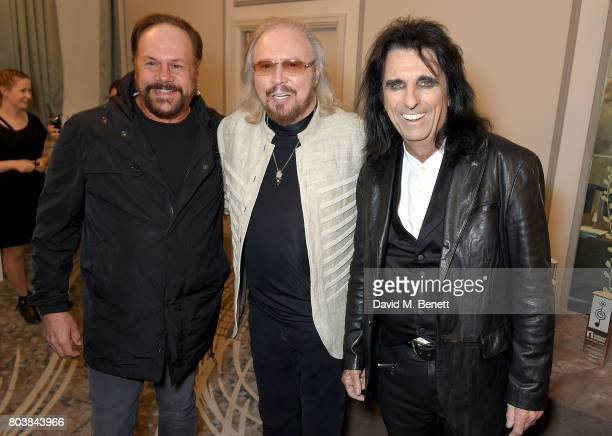 Harry Wayne Casey Barry Gibb and Alice Cooper attend the Nordoff Robbins O2 Silver Clef Awards at The Grosvenor House Hotel on June 30 2017 in London...