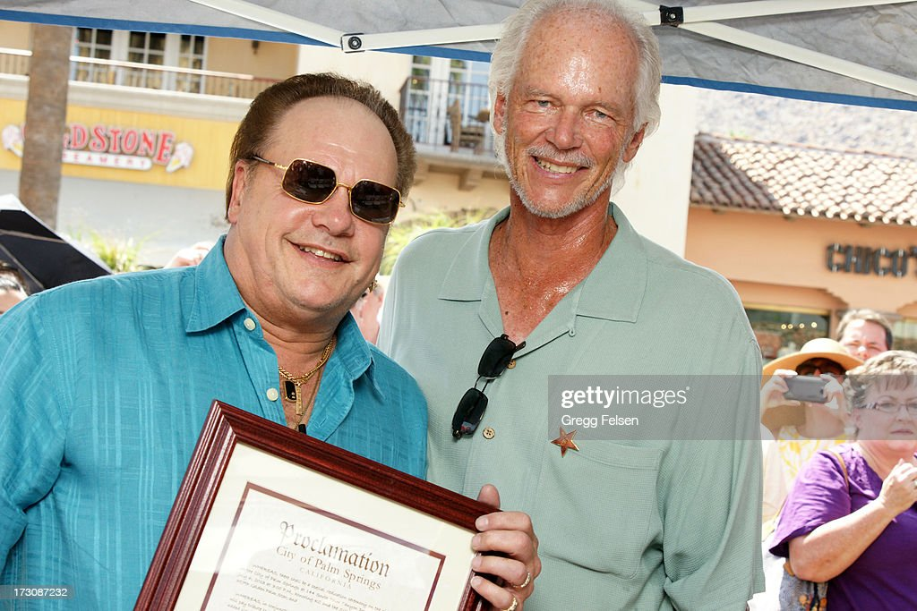 Harry Wayne 'KC' Casey and Mayor pro tem of Palm Springs <a gi-track='captionPersonalityLinkClicked' href=/galleries/search?phrase=Chris+Mills&family=editorial&specificpeople=243025 ng-click='$event.stopPropagation()'>Chris Mills</a> attend Palm Springs 'Walk of Stars' ceremony for KC And The Sunshine Band on July 6, 2013 in Palm Springs, California.