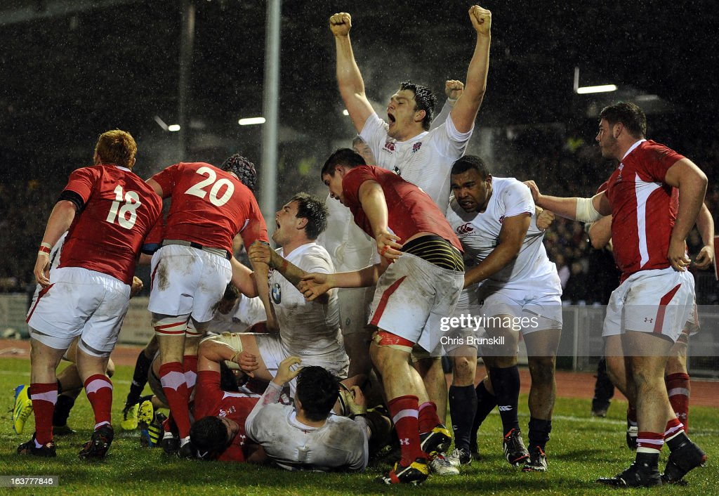 Harry Wells (C) of England U20 celebrates after going over for a try during the match between Wales U20 and England U20 at Eirias Park on March 15, 2013 in Colwyn Bay, Wales.