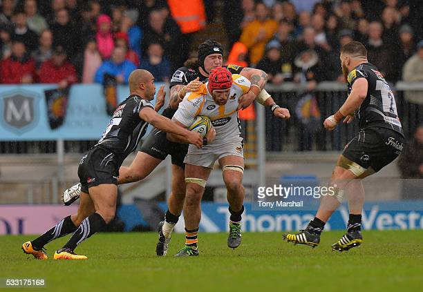 Harry Williams of Exeter Chiefs tackles James Haskell of Wasps during the Aviva Premiership semi final match between Exeter Chiefs and Wasps at Sandy...