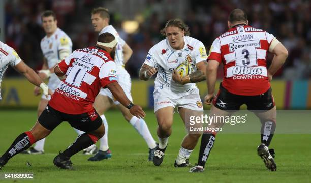 Harry Williams of Exeter takes on John Afoa and Fraser Balmain during the Aviva Premiership match between Gloucester Rugby and Exeter Chiefs at...