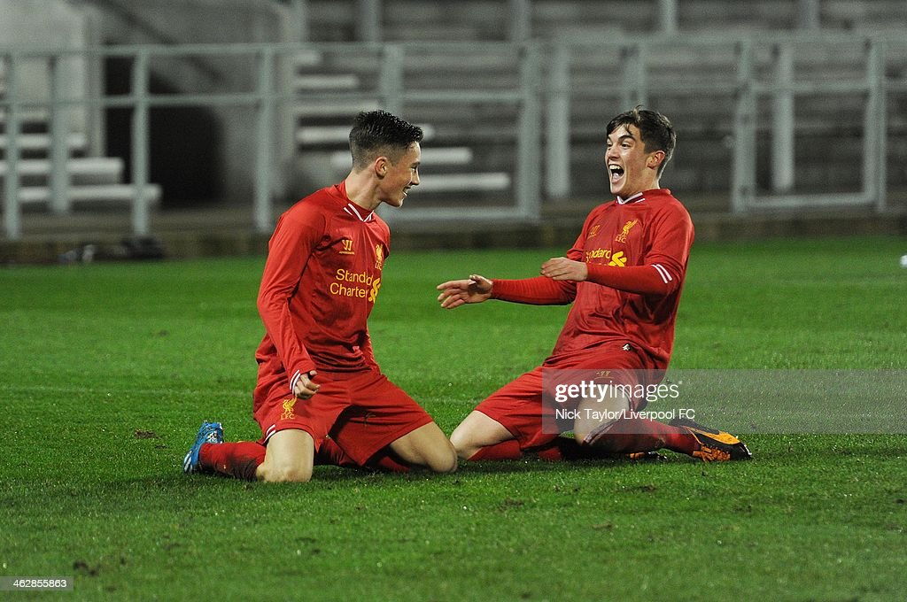 Harry Wilson celebrates his first goal of the game with Liverpool team mate Daniel Trickett-Smith during the FA Youth Cup Fourth Round fixture between Liverpool and Aston Villa at Langtree Park on January 15, 2014 in St Helens, England.
