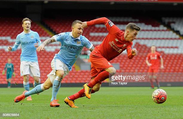 Harry Wilson of Liverpool and Angel Tasende of Manchester City in action during the Liverpool v Manchester City Barclays U21 Premier League game at...