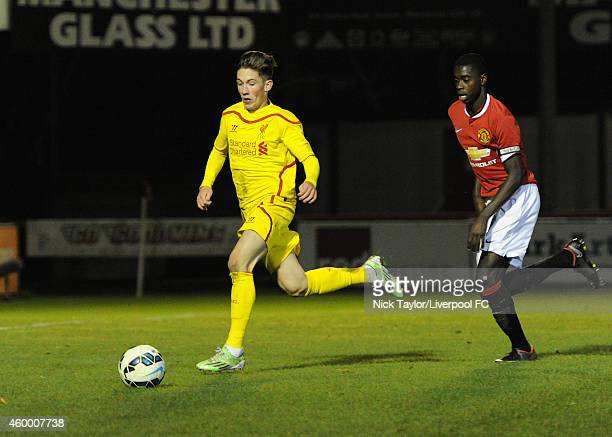 Harry Wilson of Liverpool and Axel Tuanzebe of Manchester United in action during the Barclays Premier League Under 18 fixture between Manchester...
