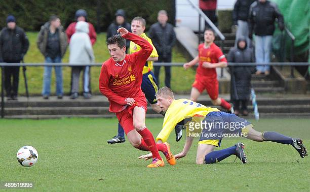 Harry Wilson of Liverpool and Thomas Robson of Sunderland in action during the Barclays Premier League Under 18 fixture between Liverpool and...