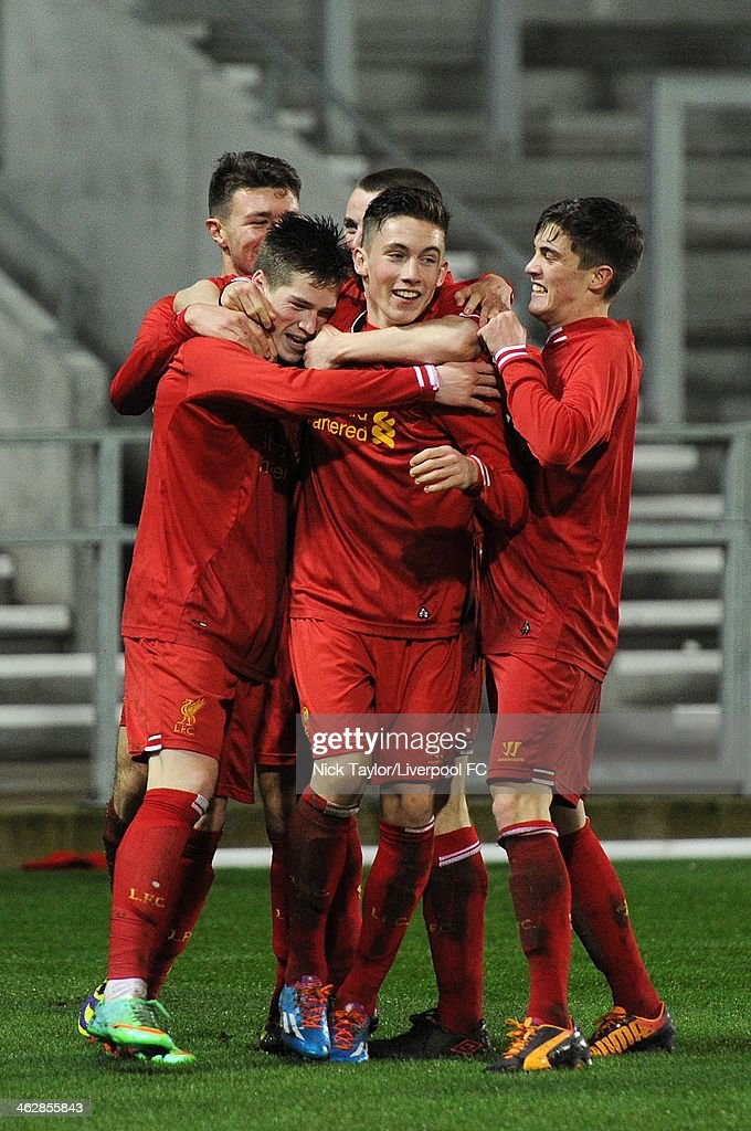 Harry Wilson (centre) of Liverpool celebrates his second goal of the game with his team mates during the FA Youth Cup Fourth Round fixture between Liverpool and Aston Villa at Langtree Park on January 15, 2014 in St Helens, England.