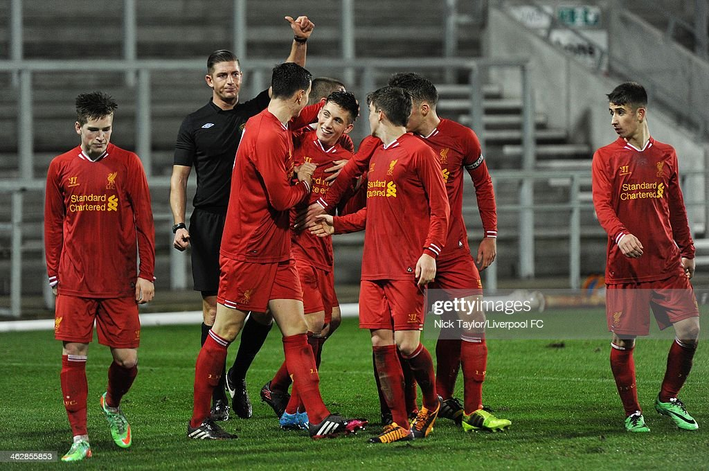Harry Wilson (with blue boots) of Liverpool celebrates his second goal of the game with his team mates during the FA Youth Cup Fourth Round fixture between Liverpool and Aston Villa at Langtree Park on January 15, 2014 in St Helens, England.