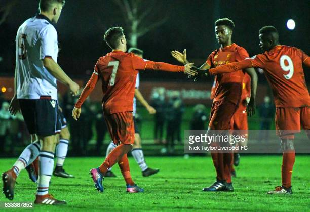 Harry Wilson of Liverpool celebrates scoring his second penalty of the game with team mates Madger Gomes and Toni Gomes during the Liverpool v Bolton...