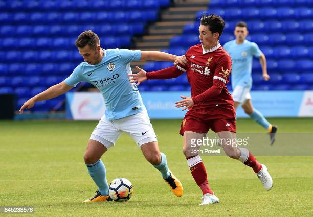 OUT Harry Wilson of Liverpool Charlie Oliver of Manchester City during the game at Prenton Park on September 10 2017 in Birkenhead England
