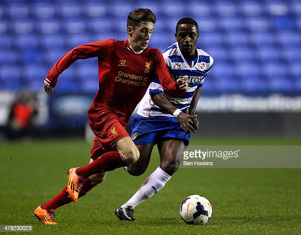 Harry Wilson of Liverpool holds off pressure from Tarique Fosu of Reading during the FA Youth Cup 6th Round match between Reading U18 and Liverpool...