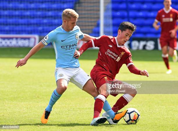 OUT Harry Wilson of Liverpool with Jacob Davenport of Manchester City during the game at Prenton Park on September 10 2017 in Birkenhead England