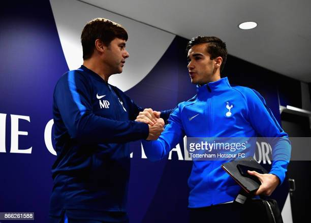 Harry Winks and Mauricio Pochettino Manager of Tottenham Hotspur arrive prior to the Carabao Cup Fourth Round match between Tottenham Hotspur and...