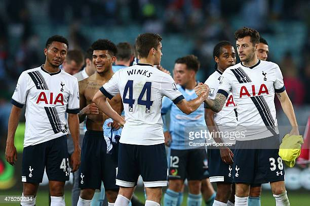 Harry Winks and Ryan Mason of Hotspur embrace after winning the international friendly match between Sydney FC and Tottenham Spurs at ANZ Stadium on...