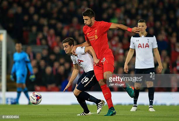 Harry Winks of Tottenham battles with Marko Grujic of Liverpool during the EFL Cup fourth round match between Liverpool and Tottenham Hotspur at...