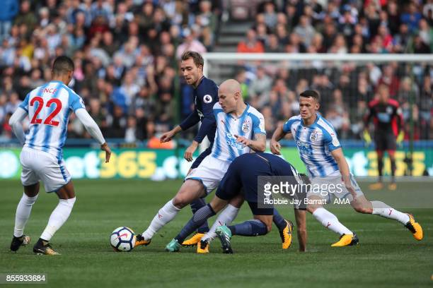 Harry Winks of Tottenham Hotspur and Aaron Mooy of Huddersfield Town during the Premier League match between Huddersfield Town and Tottenham Hotspur...