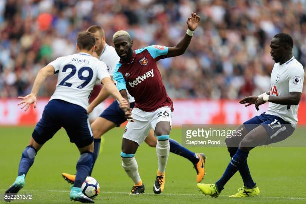 Harry Winks of Tottenham Hotspur and Arthur Masuaku of West Ham United battle for possession during the Premier League match between West Ham United...