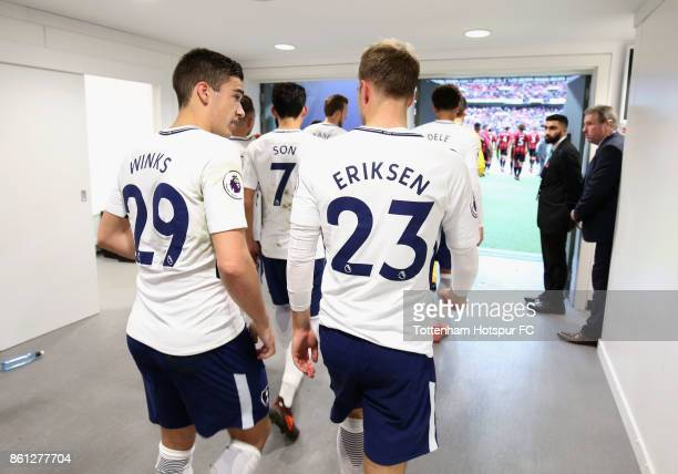 Harry Winks of Tottenham Hotspur and Christian Eriksen of Tottenham Hotspur walk out of the tunnel for the second half during the Premier League...