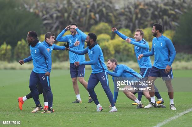 Harry Winks of Tottenham Hotspur and GeorgesKevin Nkoudou of Tottenham Hotspur celebrate as they win a training game as team mates appeal to the...