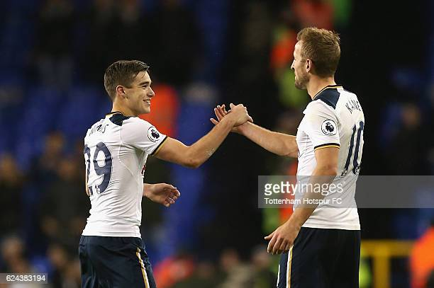 Harry Winks of Tottenham Hotspur and Harry Kane of Tottenham Hotspur embrace after the final whistle during the Premier League match between...