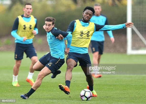 Harry Winks of Tottenham Hotspur and Joshua Onomah of Tottenaham Hotspur compete for the ball during a Tottenham Hotspur training session at the...